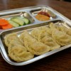 http://www.milkbarmag.com/2010/12/13/discovering-the-nepalese-dumpling/